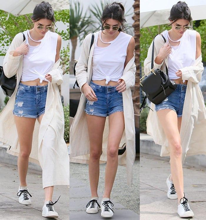 Kendall-Jenner-legs-midriff-denim-shorts-ripped-tee