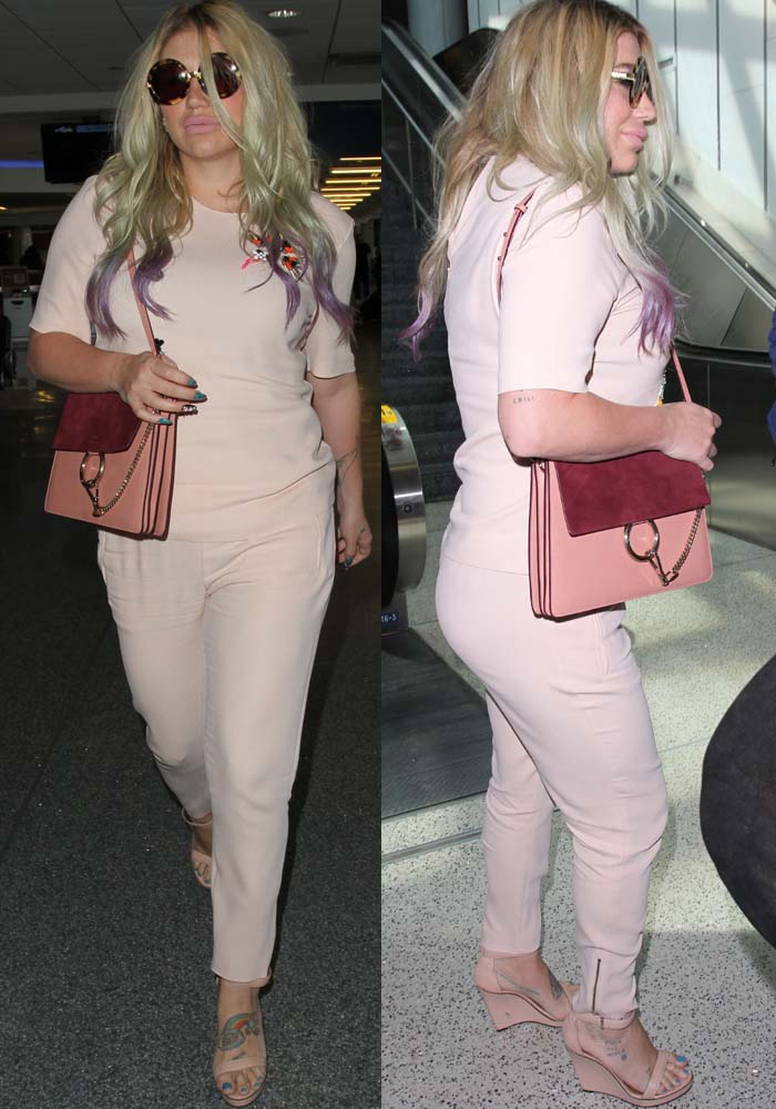 Kesha's pink top with a floral embroidery detail on the left shoulder