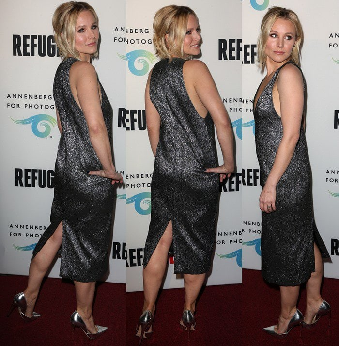 Kristen Bell in a low-cut silver dress at the Refugee Exhibit Opening
