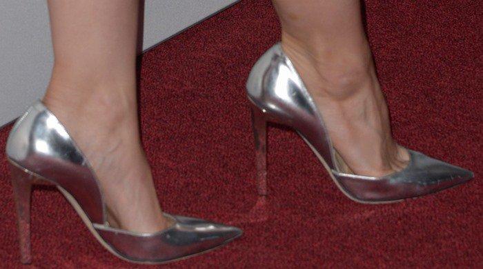 Kristen Bell shows off her feet in metallic pointy-toe Jimmy Choo pumps