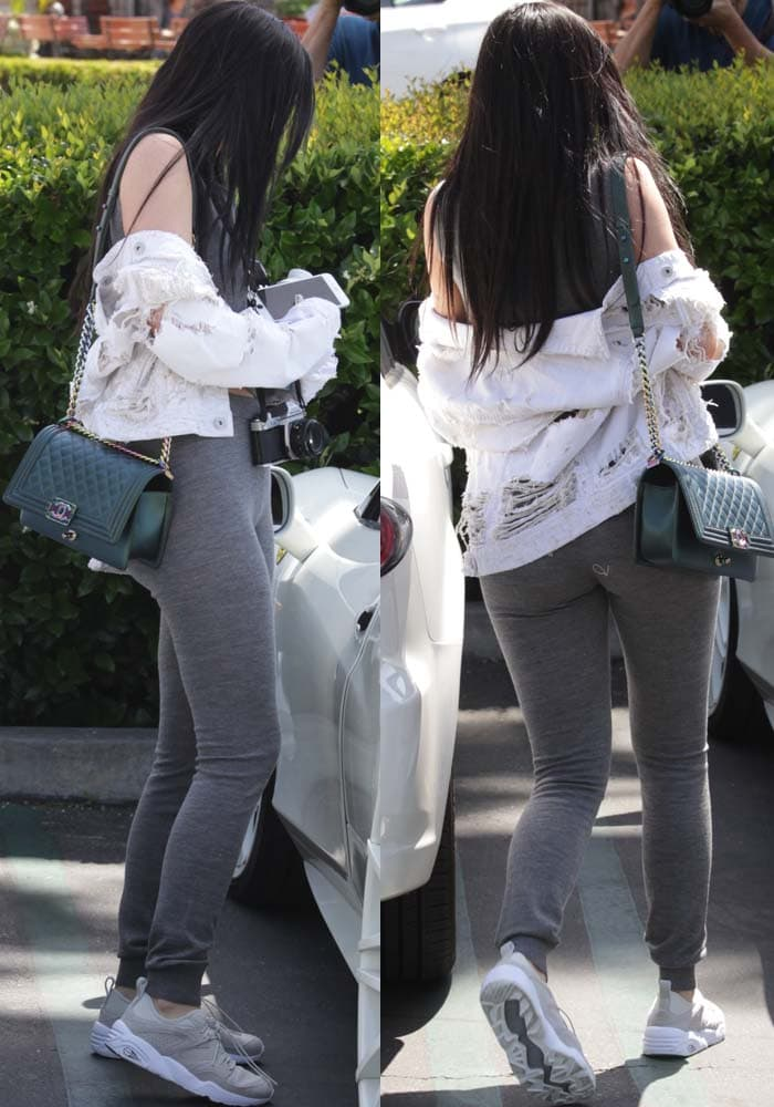 Kylie Jenner goes sporty-rugged in matching crop top and track pants