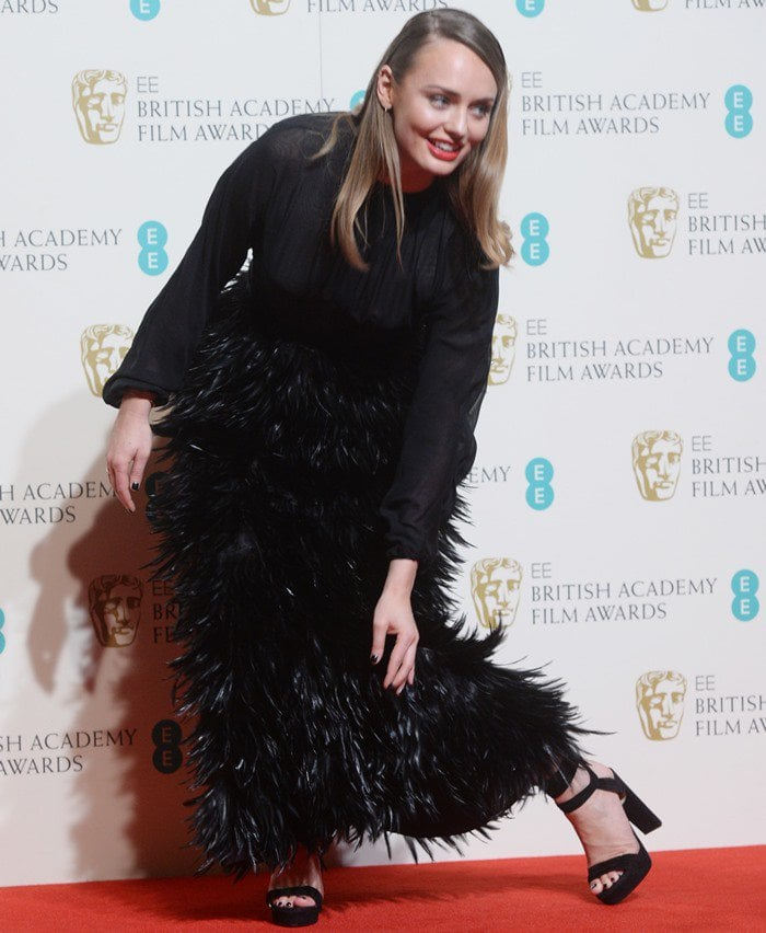 English actress Laura Jane Haddock wore the 'Kaytrin' sandals in black to the 2016 EE British Academy Film Awards held at the Royal Opera House on February 14 in London