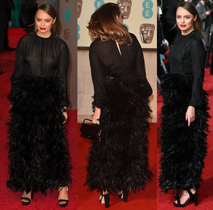 Laura Haddock styled her heels with an unflattering black gown with a crow-feathered skirt