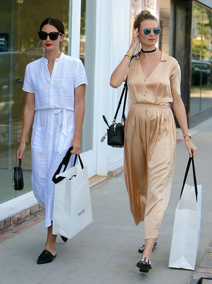 Lily-Aldridge-Behati-Prinsloo-matching-midi-dresses-slide-sandals
