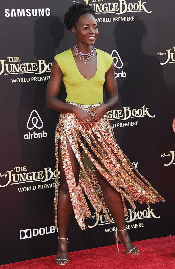 Lupita Nyong'o flaunted her legs in a gold disc-embellished maxi skirt