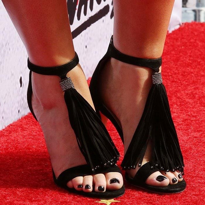 Meghan Trainor's feet in Jimmy Choo tassel sandals