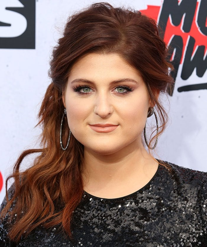 Meghan Trainor accessorized with large hoop earrings