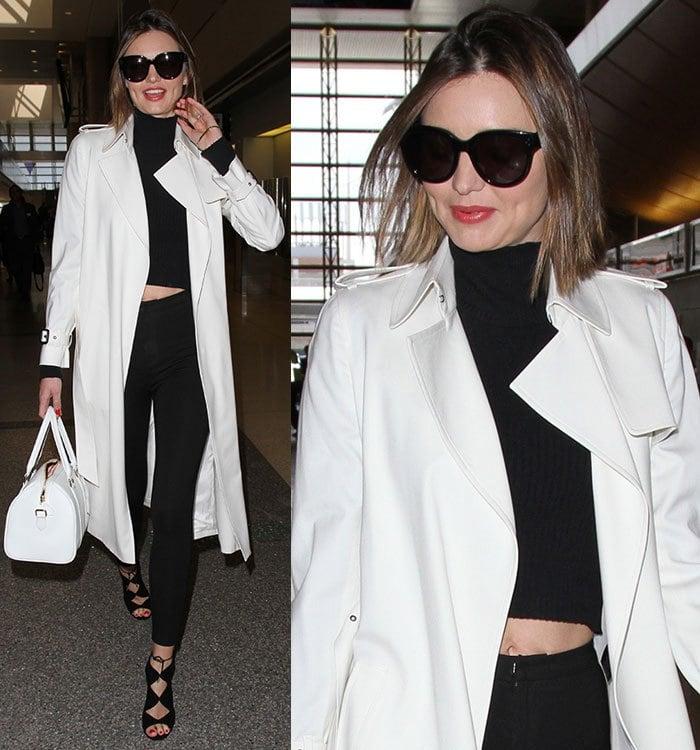 Miranda-Kerr-white-coat-black-crop-top-jeans
