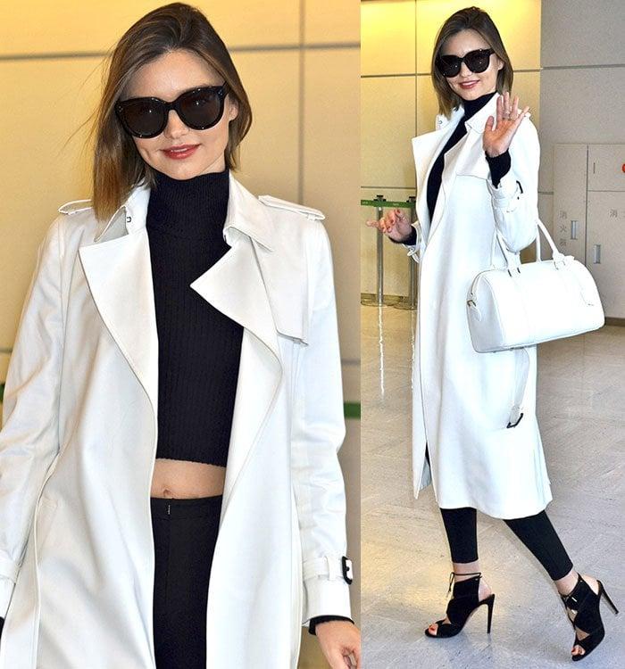 Miranda-Kerr-white-coat-black-knit-crop-top-jeans