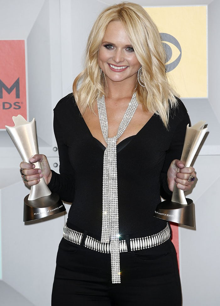 Miranda Lambert in a black Alice + Olivia jumpsuit with custom crystal-embellished belt and scarf