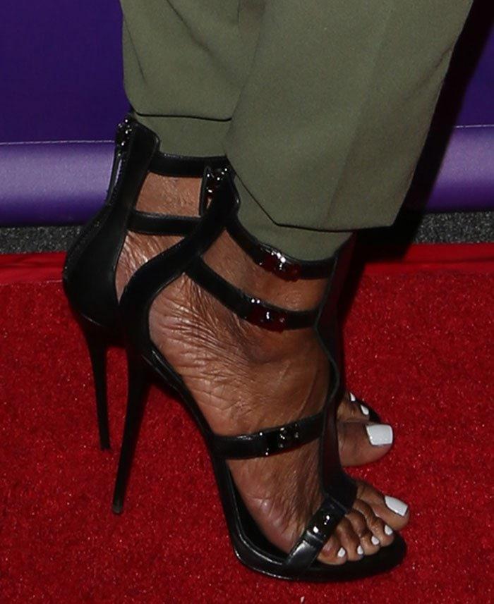 Nene Leakes' feet in black strappy sandals