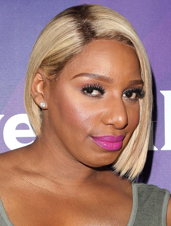 Nene Leakes'sleek side-parted bob, bronzed glow and fuchsia pink lipstick glammed up her look
