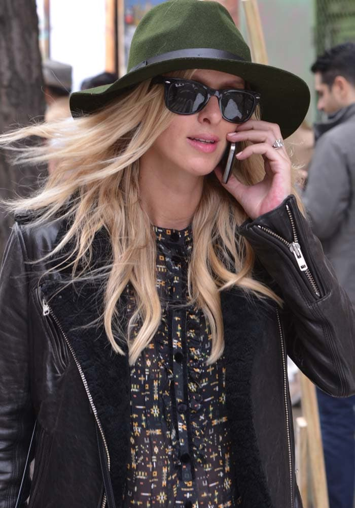 Nicky Hilton chats on her mobile phone while out walking in Soho