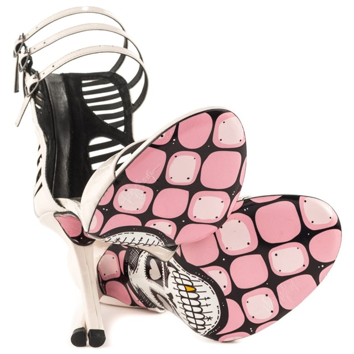A 5 inch heel stands tall enough to showcase a pink square and skull print
