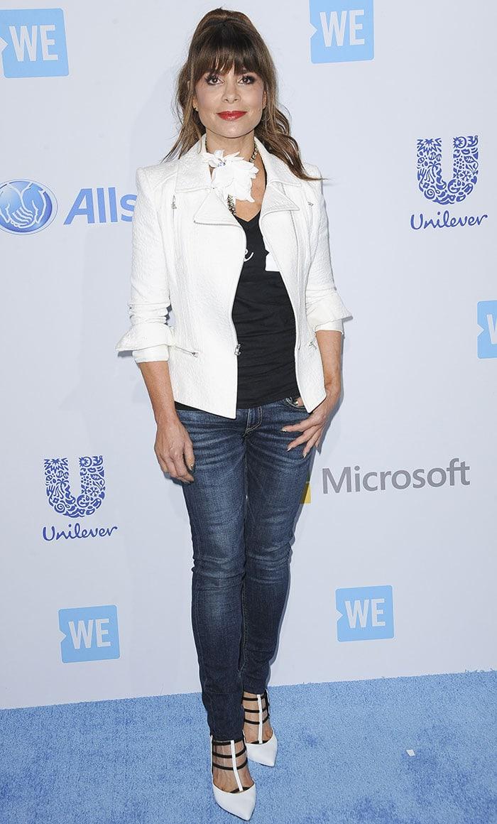 Paula-Abdul-black-top-white-jacket-jeans