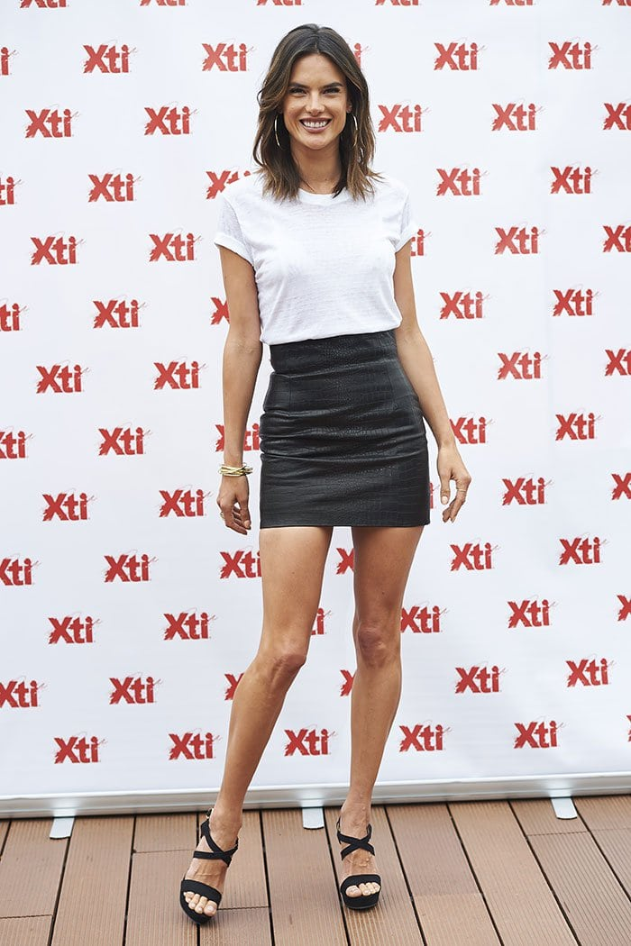 Alessandra Ambrosio flaunts her endless legs in a skintight thigh-grazing leather skirt