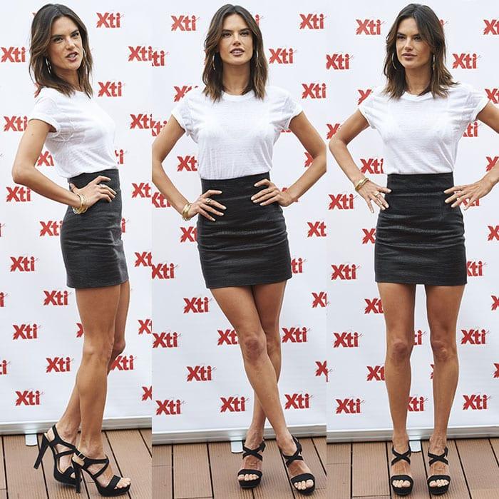 Alessandra Ambrosio flaunts her legs in a leather mini skirt and a plain white tee by Mate the Label