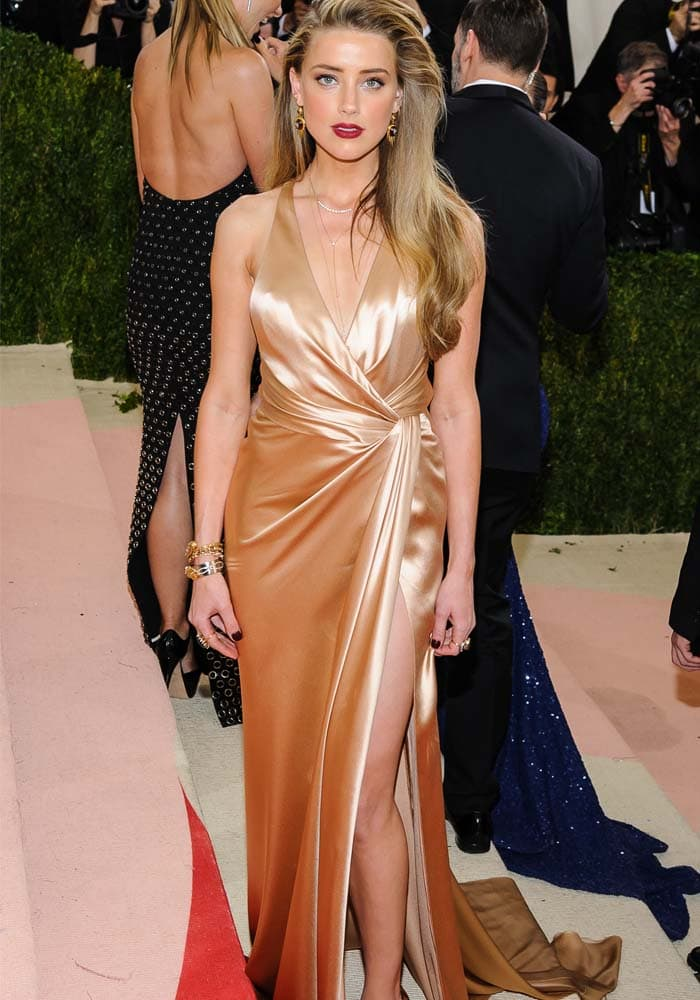Amber Heard stuns in a custom charmeuse Ralph Lauren Collection dress in champagne