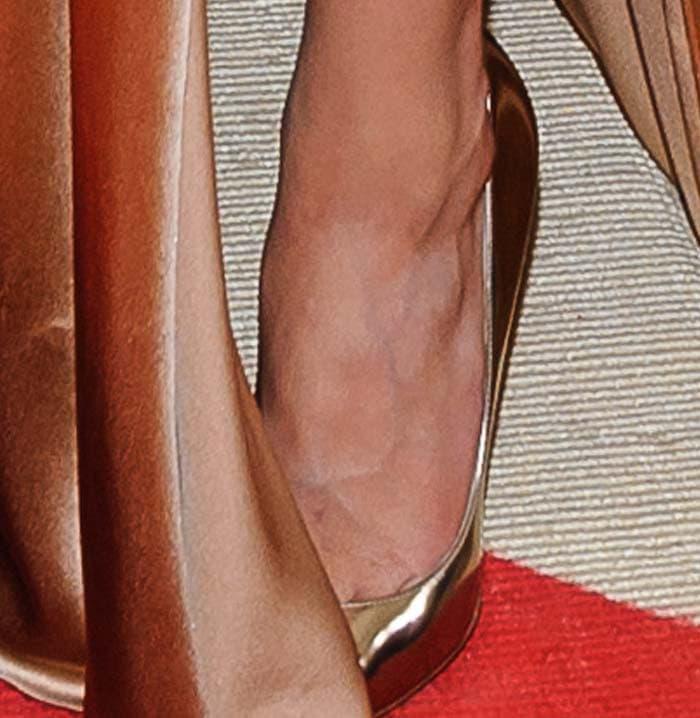 """Amber Heard complements her Ralph Lauren dress with Jimmy Choo """"Anouk"""" pumps"""