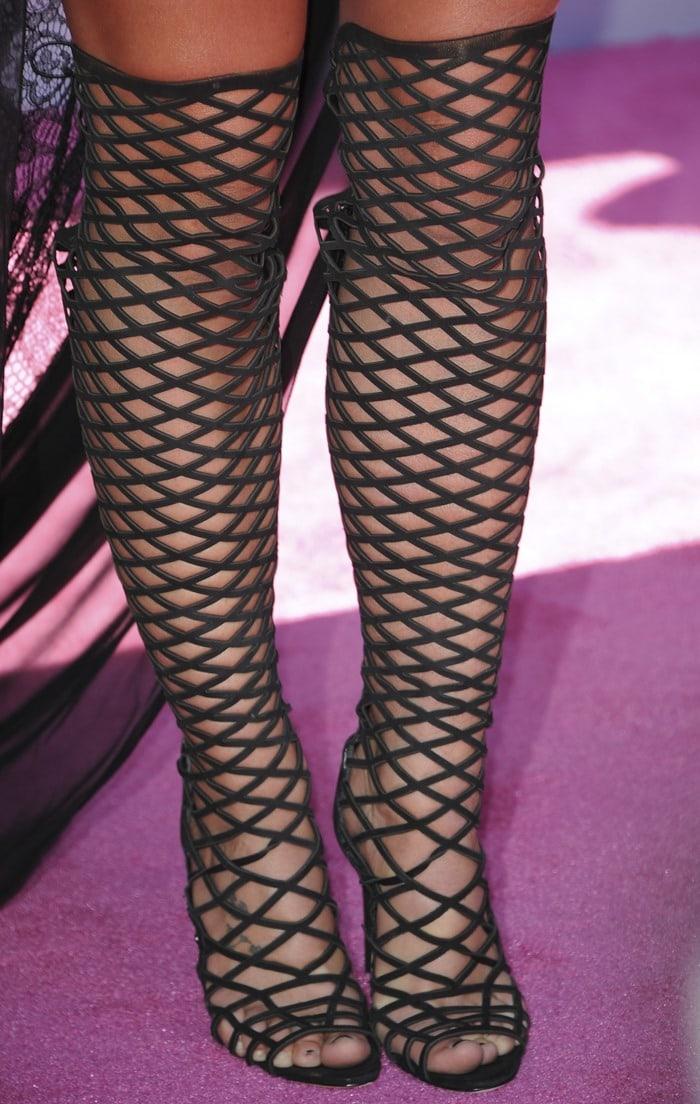 Britney Spears in Schutz Karlyanna knee-high leather heels