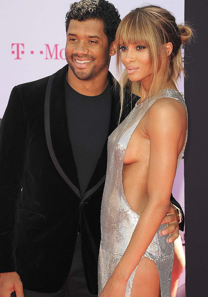 Russell Wilson couldn't take his hands off fiancé Ciara