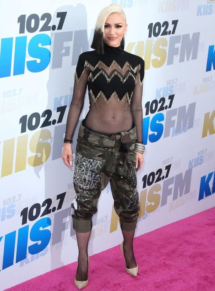 Gwen-Stefani-dip-dye-hair-sheer-top-camo-pants