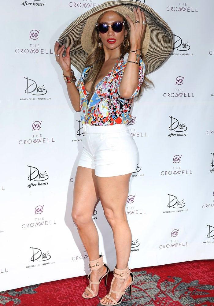 Jennifer Lopez in a two-piece Emilio Pucci printed bikiniunderneath a matching jacket