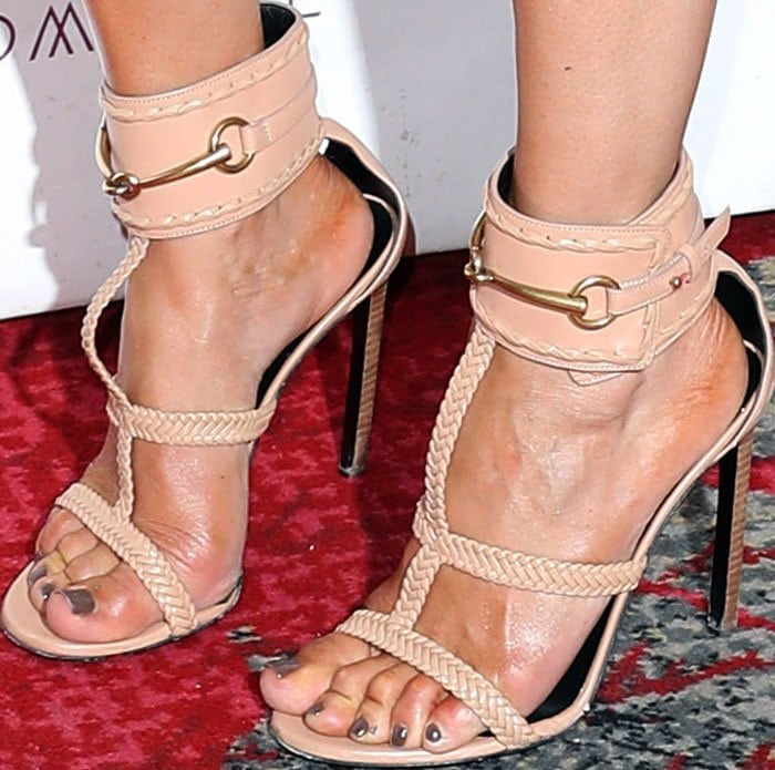 J.Lo kept her pool wear in style as she hit the red carpet in Gucci Ursula braided sandals