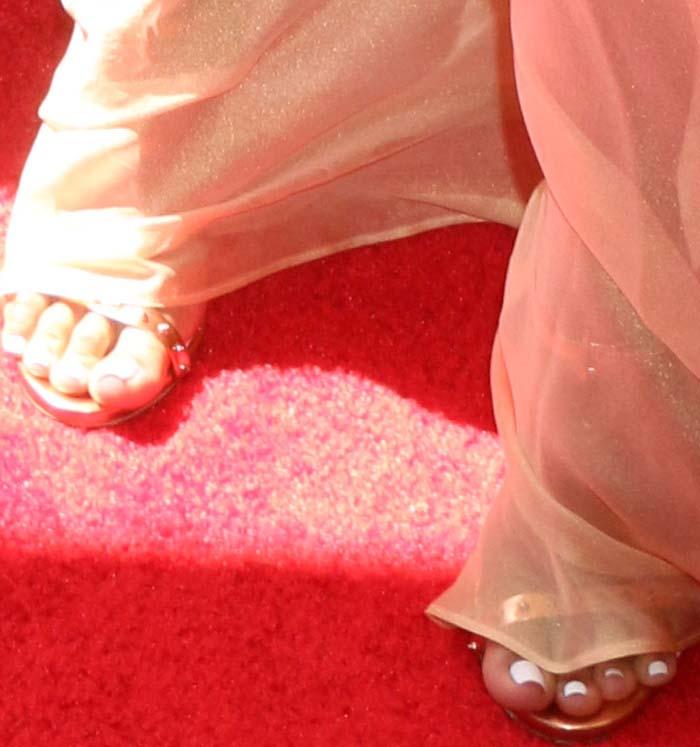 "Karrueche goes spiked metallic with the Ruthie Davis ""Paris"" sandals"