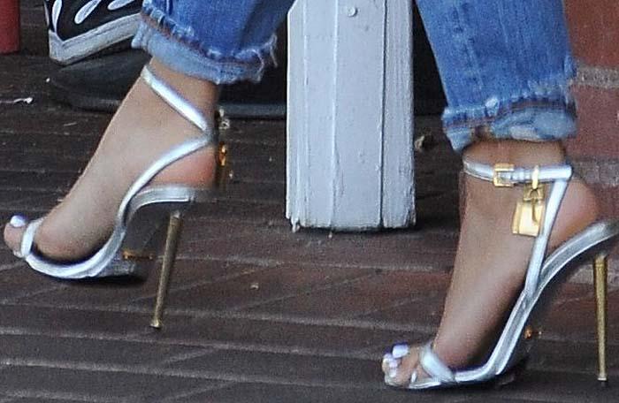 Karrueche Tran shows off her feet insilver Tom Ford padlock sandals
