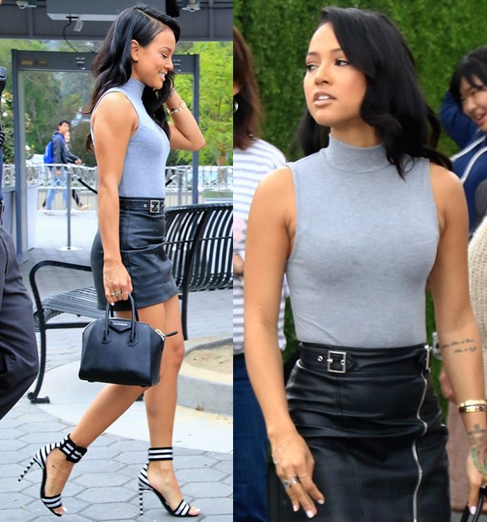 Karrueche Tran turned heads in a sleeveless gray top with a high neck and a black leather mini skirt