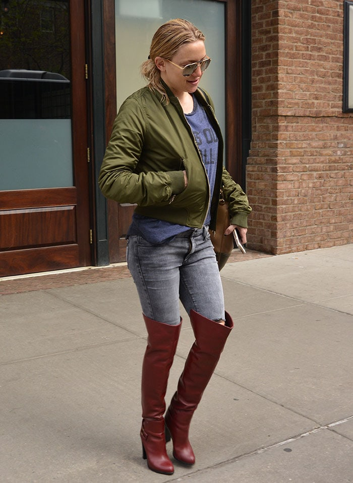 Makeup-Free Kate Hudson wearing an army green jacket while out in Manhattan
