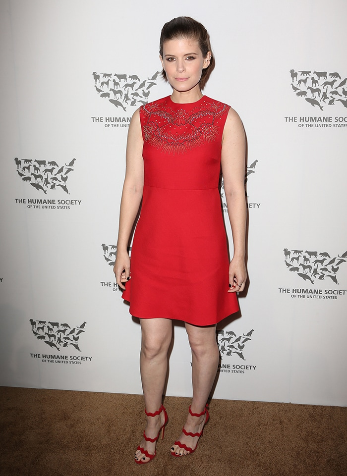 Kate Mara completed the all-red look with Prada sandals