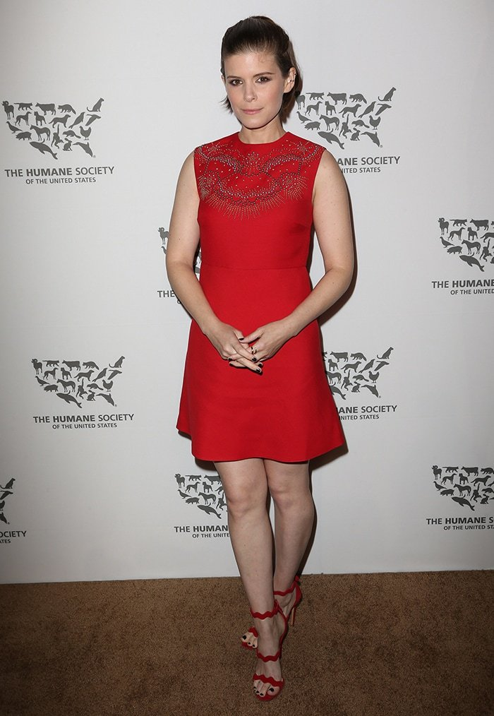 Kate Mara flaunting her sexy feet and legs in asleeveless red dress