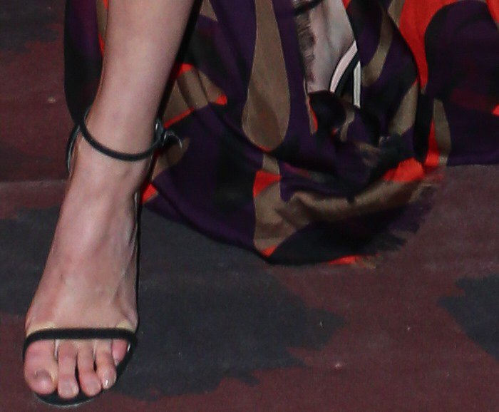 Kendall Jenner displays her toes in black sandals