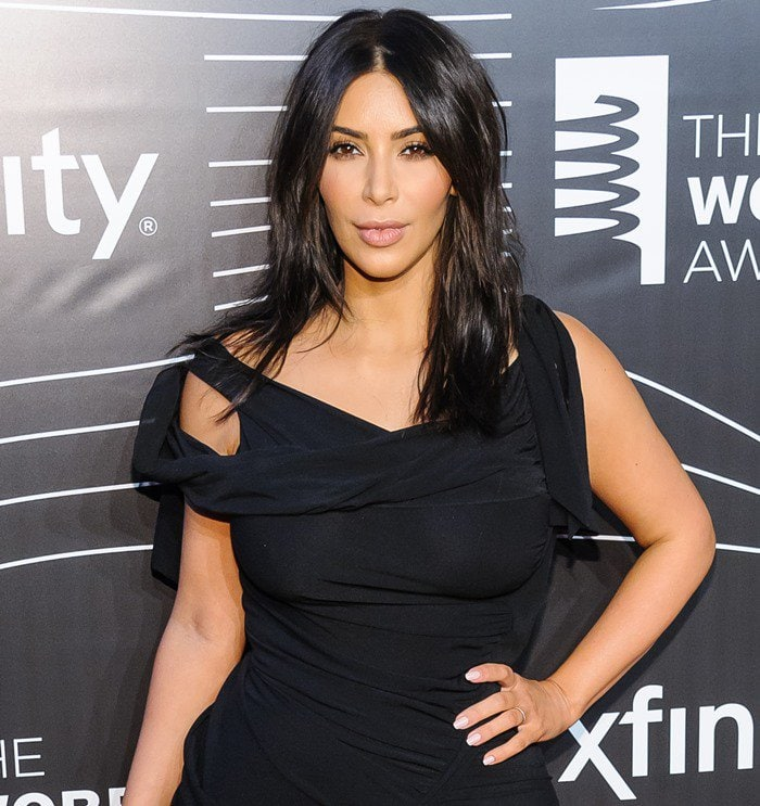 Kim Kardashian received the first ever Break the Internet Award and proudly posed for the cameras