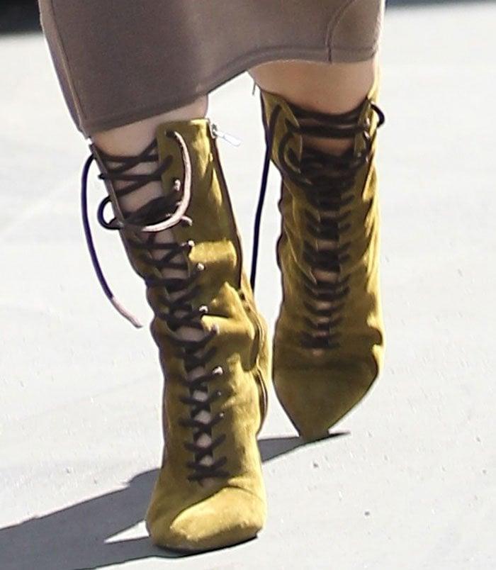 Kim Kardashian in khaki suede boots