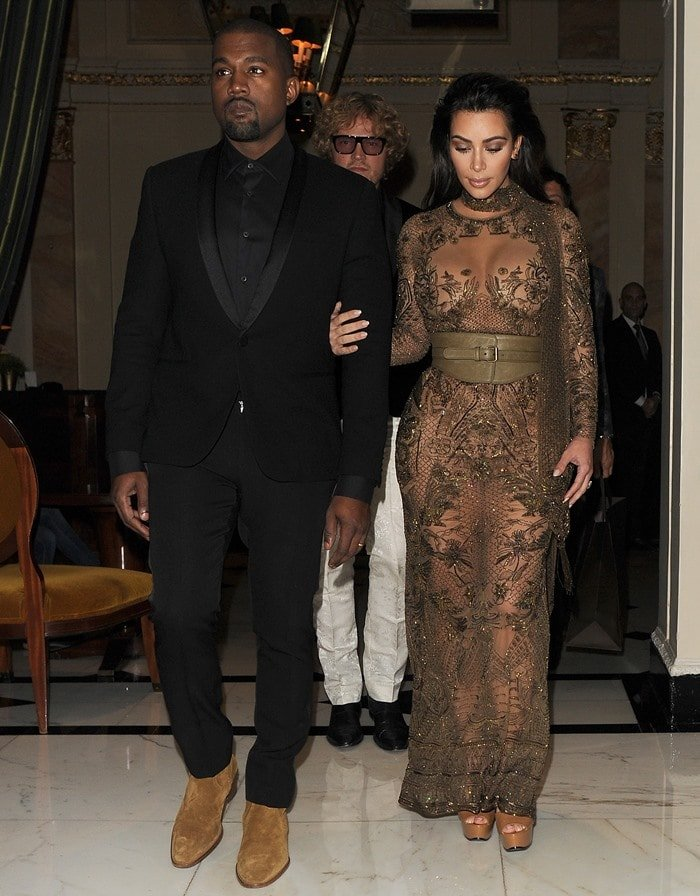 Kim Kardashian left little to the imagination in her horrific ultra-sheer, embroidered dress