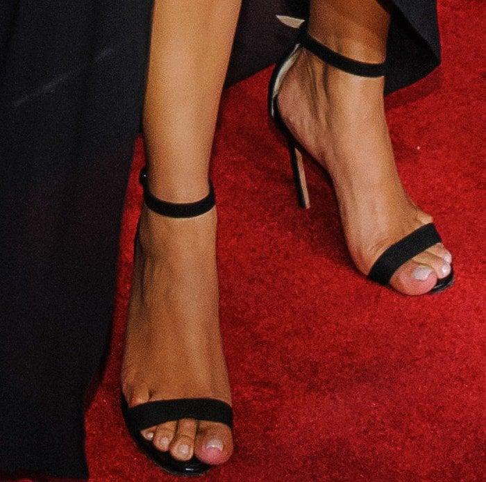 Kim Kardashian in black ankle-strap sandals