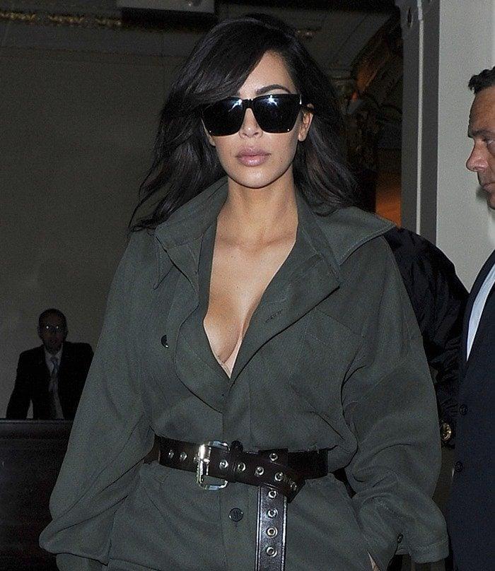 Kim Kardashian and her husband Kanye West leave the Dorchester Hotel