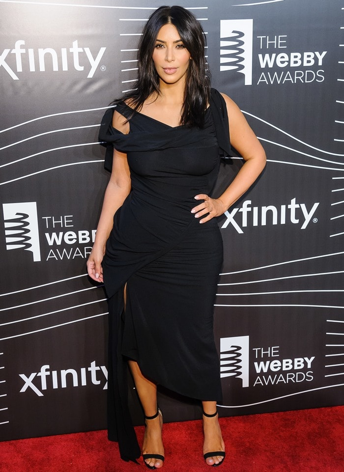 Kim Kardashian in a black dress while on the red carpet at the 2016 Webby Awards