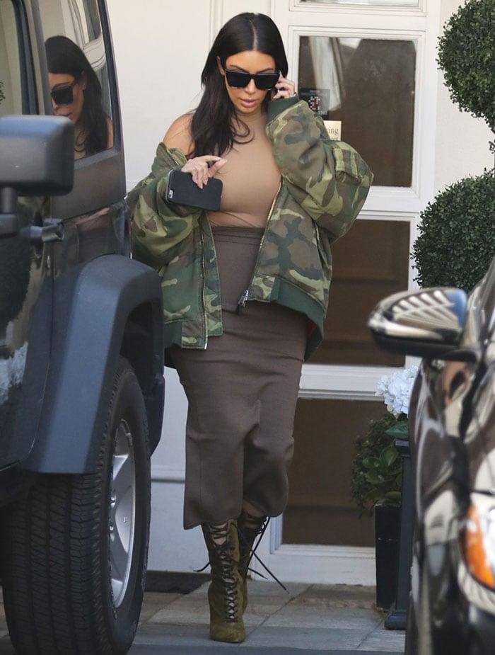 Kim Kardashian wearing Kanye'scamo-printed bomber jacket from the Raf Simons AW01 collection