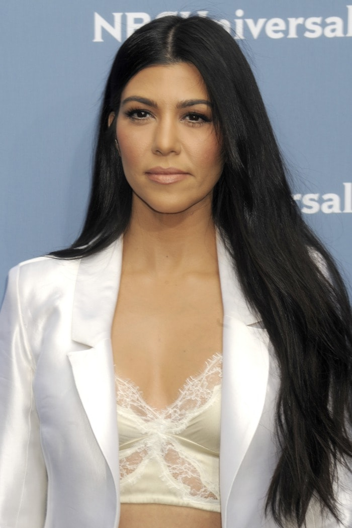 Kourtney Kardashian turned the sexiness on full blast by adding a lingerie-like bralette that made her chest the focal point of the outfit