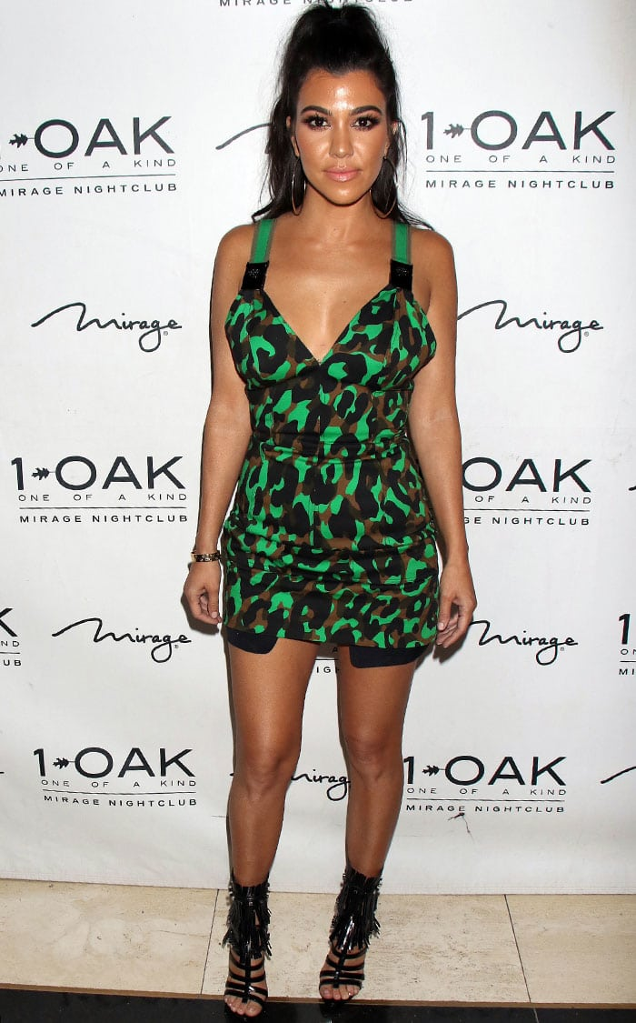 Kourtney Kardashian in a camouflage-printed mini dress from Versace's Spring/Summer 2016 collection
