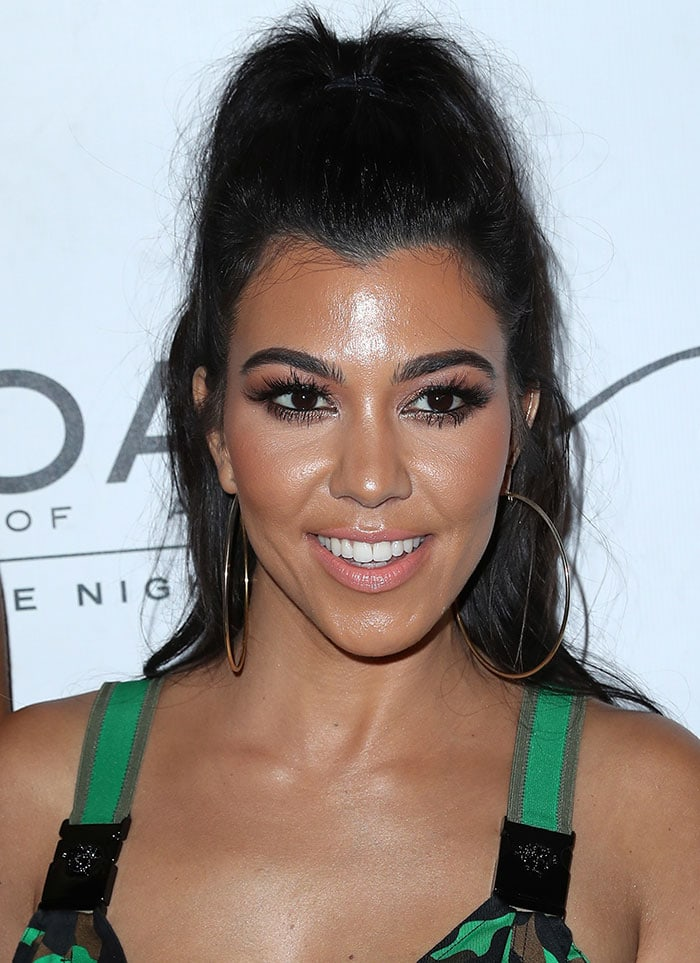 Kourtney Kardashian pulled her raven locks into a high ponytail and accentuated her stunning facial features with subtle smoky eye-makeup, mascara and nude lipstick