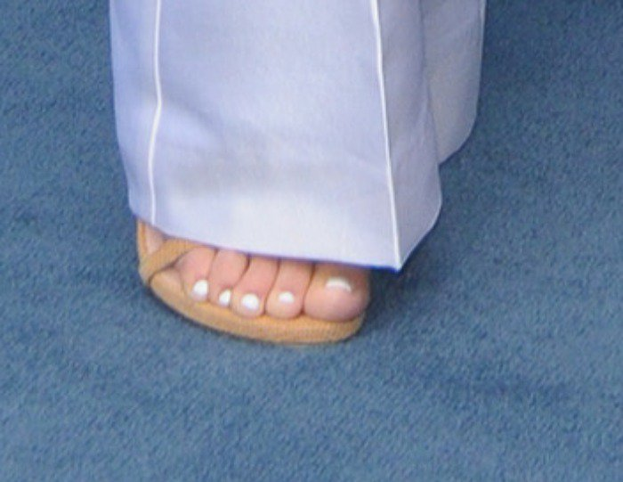 Kourtney Kardashian showing off her feet in tan sandals