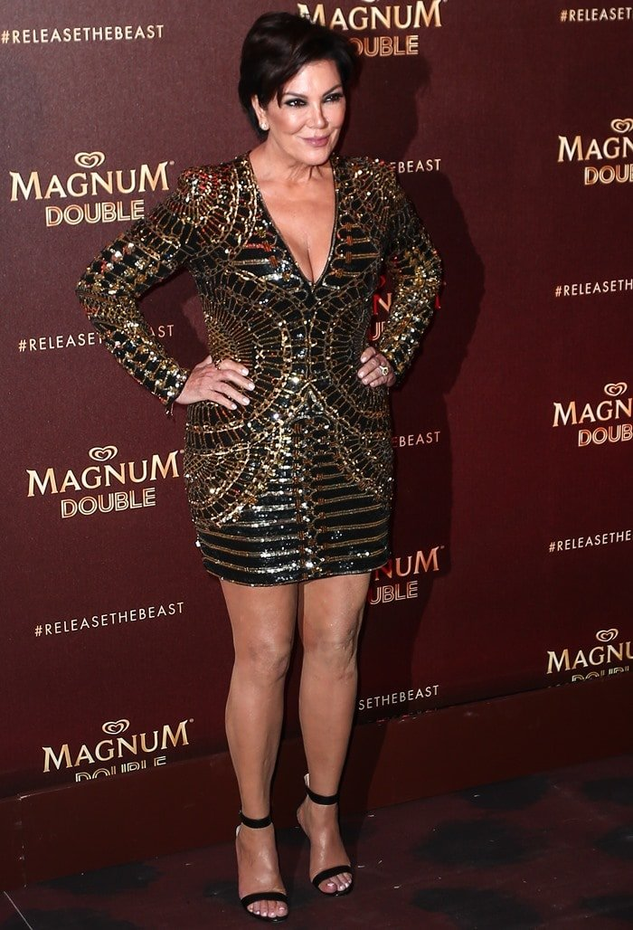 Kris Jenner styled the mini dress with dark smokey eyes and a black ankle-strap sandals
