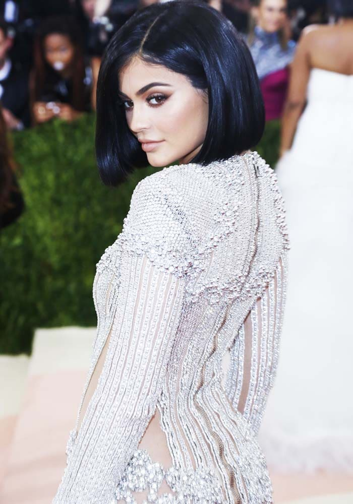Kylie Jenner displays the intricately made Balmain dress from family friend and head designer Olivier Rousteing