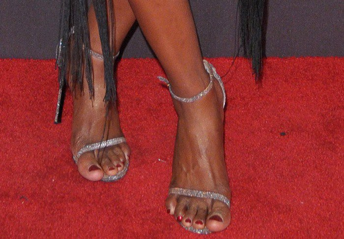 Laverne Cox in silver Stuart Weitzman ankle-strap sandals
