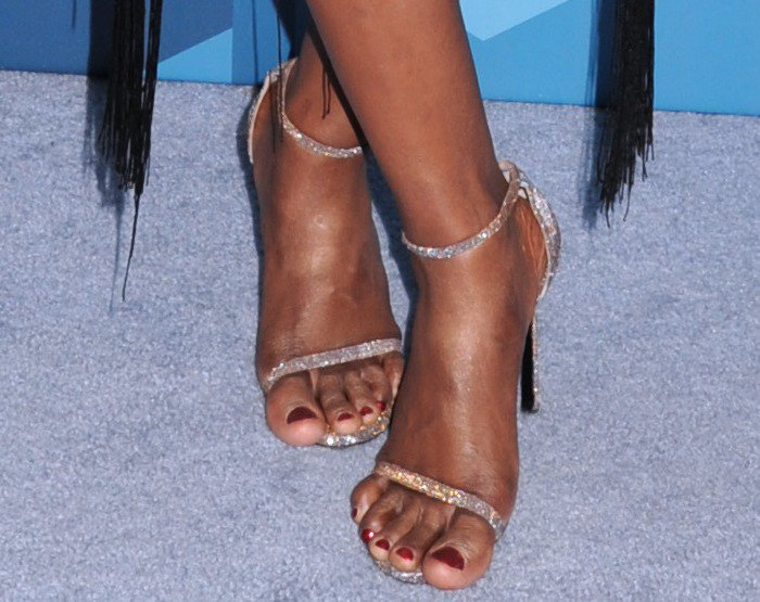 Laverne Cox showing off her feet in glittering heels